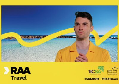Man in front of green screen of tropical beach