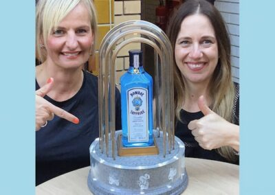 2 ladies photographed with bottle of Bombay Sapphire