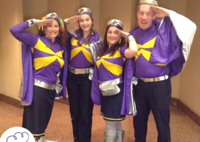 guests dressed in purple super hero costumes roaming event photographer