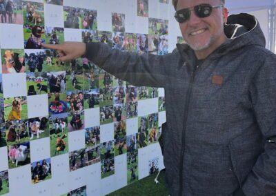 man pointing at photo mosaic